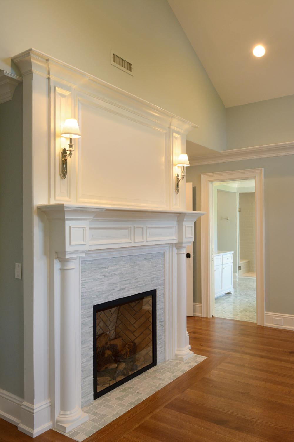 The home features seven Town & Country fireplaces with custom designed fireplace mantles